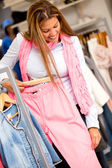 Woman buying clothes — Stock Photo