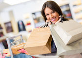 Portrait of shopaholic woman smiling — Stock Photo