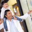 Father and son window shopping - Stock Photo