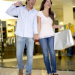 Shopping couple laughing — Stock Photo