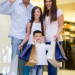 Stock Photo: Happy family shopping