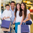 Family at the shopping center — Stock Photo #22976736