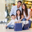 Beautiful family shopping — Stock Photo #22976744