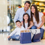 Beautiful family shopping — Stock Photo