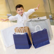 Excited shopping boy — Stock Photo