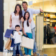 Family shopping with thumbs up — Stock Photo