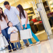 Family with shopping bags — Stock Photo #22976812