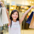Girl holding shopping bags — Stock Photo