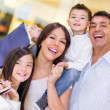 Happy family shopping — Stock Photo #22976846