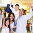 Excited family shopping — Stok fotoğraf
