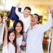 Foto Stock: Excited family shopping