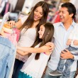 Family shopping for clothes — Stock Photo