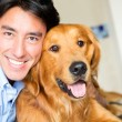 Happy man with a dog — Stock Photo