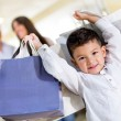 Happy little boy shopping — Stock Photo