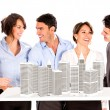 Stock Photo: Group of architects with a building project
