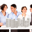 Group of architects with a building project — Stock Photo
