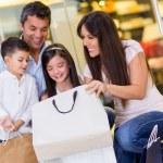 Happy family at the mall — Stock Photo