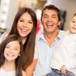 Happy family in a clothing store — Stock Photo