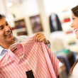 Couple buying clothes - Stock Photo