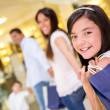 Family shopping at the mall — Stock Photo