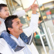 Stock Photo: Father and son at the shopping center