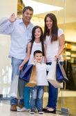 Happy family shopping — Stock Photo