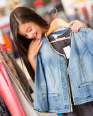 Girl shopping for clothes — Stock Photo
