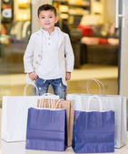 Adorable little boy shopping — Stock Photo