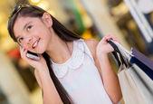 Girl talking on the phone — Stockfoto