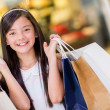 Girl holding shopping bags — Stock Photo #23223844