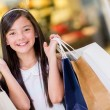 Girl holding shopping bags - Stock Photo