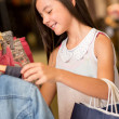 Stock Photo: Cute girl shopping