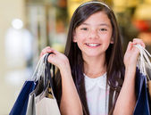 Happy girl shopping — Stock Photo