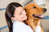 Doctor hugging a dog — Stock Photo