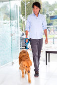 Man taking dog to the vet — Stock Photo