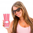 Woman eating popcorn at the movies — Stock Photo