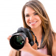 Female photographer with a camera — Stock Photo