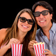 Happy couple watching a 3D movie — Stock Photo #23511427
