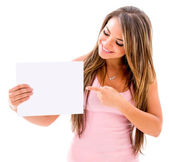 Woman pointing at a banner — Stock Photo