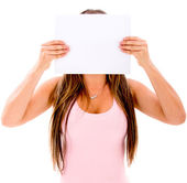 Woman covering her face — Stock Photo