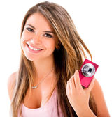 Happy woman with a camera — Stock Photo
