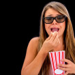 Scared woman watching 3D movie — Stock Photo