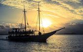 Boat sailing at sunset — Stock Photo