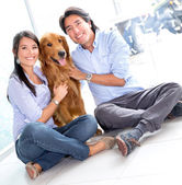 Couple taking dog to the vet — Stock Photo