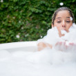 Happy woman taking a bubble bath — Stock Photo #23713919