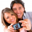 Happy couple taking a picture - Stock Photo