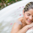 Woman in a bathtub - Stock Photo