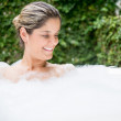 Beautiful woman in a bathtub - Stockfoto