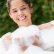 Woman playing with foam bath - Stock Photo