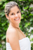 Smiling woman wearing a towel — Stock Photo